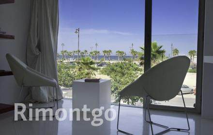 Modern villa with pool facing the beach in Valencia for sale.